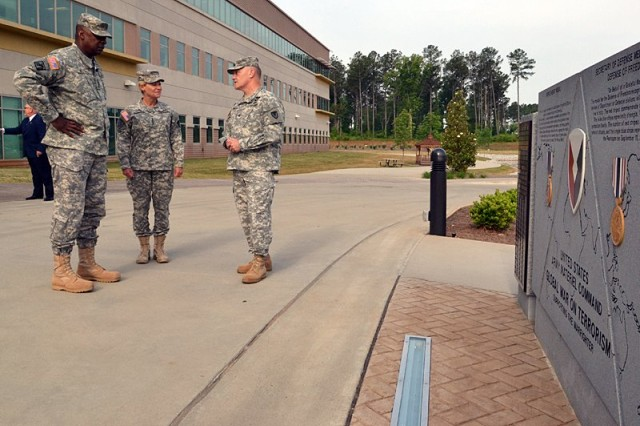 Gen. Lloyd J. Austin III, Vice Chief of Staff of the Army, recently visited the U.S. Army Materiel Command, where Gen. Ann E. Dunwoody commands. Discussions included the industrial operating base, such as AMC's depot and arsenals, and their importance to the future of the Army and how it directly relates to the readiness of America's forces. He also received a tour of the building from Col. Daniel T. Williams, director of AMC Public and Congressional Affairs. U.S. Army photo by: Chris Putman, AMC Public Affairs.