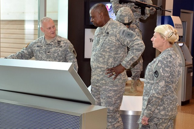Gen. Lloyd J. Austin III, Vice Chief of Staff of the Army, and Gen. Ann E. Dunwoody, Commanding General of the U.S. Army Materiel Command, views the AMC story on a reader rail in the lobby with Col. Daniel T. Williams, Director of AMC Public Affairs, on a recent visit to headquarters AMC, here at Redstone Arsenal in Huntsville, Ala.; April 27. U.S. Army Photo by Chris Putman, AMC Public Affairs.