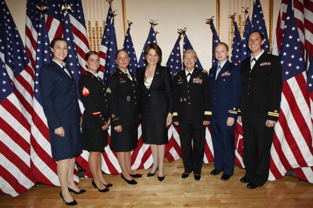 Gen. Ann E. Dunwoody (center), poses with recipients of USO awards following a May 1, 2012, USO Woman of the Year Luncheon. Pictured are: Air Force Capt. Gina Fasciani, U.S. Marine Corps Sgt. Sheen Adams, Army Sgt. Julia Bringloe, Marillyn Hewson, EVP, Electronic Systems, Lockheed Martin Corporation, Gen. Ann Dunwoody, Coast Guard Lieutenant Junior Grade Katherine Ustler, and Navy. Lt. Katherine Worstell