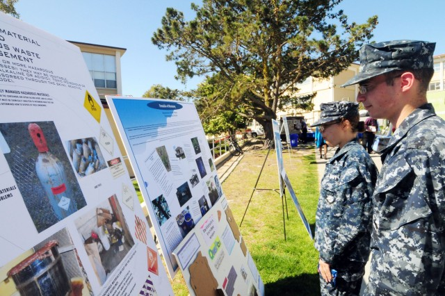 PRESIDIO OF MONTEREY, Calif. - Navy Center of Information Dominance Unit Monterey sailors read about the various types of hazardous waste and their effects on the environment during the Presidio of Monterey Earth Day event April 22.  Earth Day is now an internationally celebrated giving way to the United Nations designating the day, in 2009, as International Mother Earth Day.