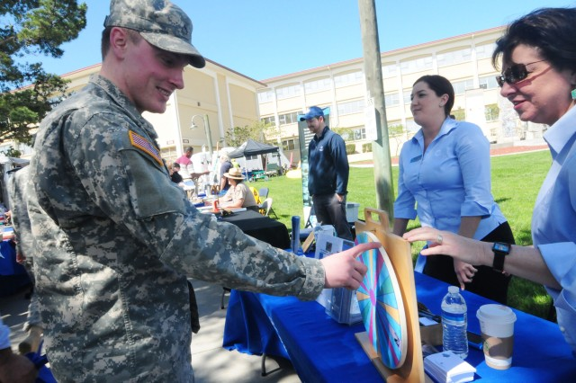 PRESIDIO OF MONTEREY, Calif. - Pvt. 1st Class Johnathon Mooney, D. Co 229th Military Intelligence Battalion, spins a prize wheel in an attempt to win two free tickets to the Monterey Bay Aquarium during the POM Earth Day event.