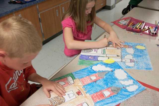 From left, Eli Swanson and Allison Wilking, third graders, work on art projects in Debbie Akery's art class at Thayer Elementary School at Fort Leonard Wood, Mo.