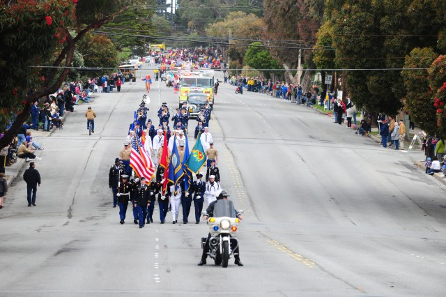 PRESIDIO OF MONTEREY, Calif. - The Defense Language Institute Foreign Language Center Honorary Color Guard followed by marching elements from the Army, Marine Corps, Navy and Air Force lead a half-mile parade through Pacific Grove, CA during the Good Old Days festival.