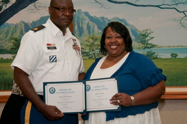 Staff Sgt. Joseph J. Steele, an air space management noncommissioned officer assigned to the 5th BCD and a Montgomery, Ala. native along with his wife Marcia A. Steele, a native of Detroit, Mich. won the Volunteer Family of the Year award.