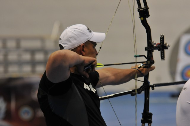 Retired Staff Sgt. Jesse White takes aim during the 2012 Warrior Games Archery Competition at the Air Force Academy in Colorado Springs, Colo. White said following the steps to hit a target in archery helped him to recover from mild traumatic brain injury.