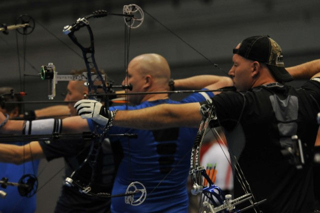 Army team member Justin Steele takes aim May 2, 2012, during the 2012 Warrior Games Archery competition at the Air Force Academy in Colorado Springs, Colo. The Army team won two individual silver medals and two team silver medals.