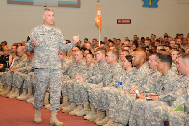 Sgt. Maj. of the Army Raymond F. Chandler III addresses Soldiers, civilians and family members during a town hall meeting at McMahon Auditorium at Fort Carson, Colo., May 2, 2012. During the meeting, Chandler discussed topics ranging from Army uniform changes to the drawdown of forces, and answered questions from the audience. The visit marked Chandler's first visit to Fort Carson since being appointed the 14th Sergeant Major of the Army.