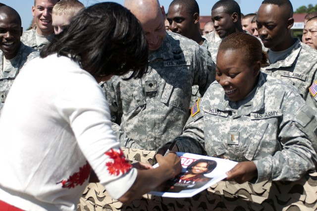 BELOW First Lady Michelle Obama signs autographs during the presidential visit to Stewart, April 27. President Barack Obama and Michelle spoke with Soldiers and Family Members.