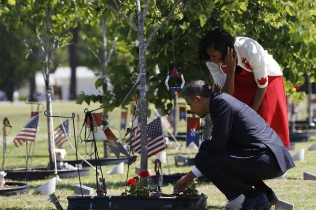 President Barack and First Lady Michelle Obama pay their respect to the Fallen 3rd ID Soldiers at Fort Stewart's Warrior Walk during their visit to Fort Stewart, April 27.