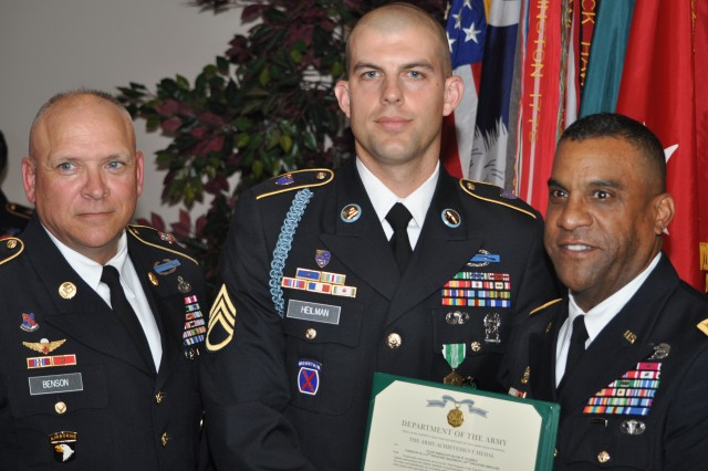 Sgt. 1st Class Jeffrey Heilman, center, accepts his award as Fort Jackson's Drill Sergeant of the Year from Brig. Gen. Bryan Roberts, right, Fort Jackson's commanding general, and Post Command Sgt. Maj. Kevin Benson