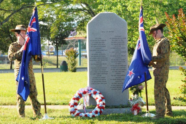 Australian service members stand in front of the 135th Assault Helicopter Company memorial in Veterans Park April 25 after the ANZAC Day ceremony to honor the members of the Australian and New Zealand Army Corps who fought at Gallipoli in Turkey during World War I.