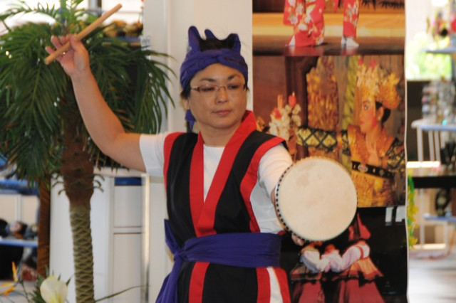 "One of the performers from Okinawa Kenjin Kai of Alabama demonstrates an eisa dance "" a drum dance paying homage to ancestors."