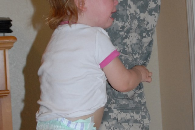 Clingy behavior is a normal reaction for preschoolers who have parents return home from deployments. Other common behavior also includes anger, fear and indifference.