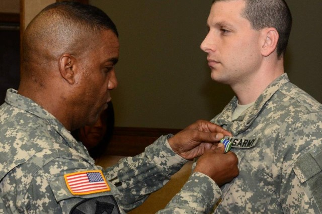 Brig. Gen. Bryan Roberts, Fort Jackson's commanding general, presents the Army Achievement Medal to Capt. Adam Wolrich. One of Roberts' pillars of his command philosophy is, 'Be good to People.' Roberts said that taking care of people is every leader's business.
