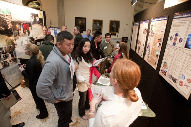 Visitors examine displays May 2, 2012, at the 6th annual Natick Soldier Systems Center Showcase at the Massachusetts State House in Boston, which brought Soldier technologies to Beacon Hill. Visitors learned about what Soldiers wear, carry and eat.