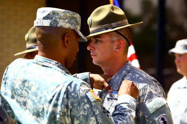 Col. Gregory Dewitt, 434th Field Artillery Brigade commander, pins the Expert Infantry Badge on Drill Sergeant (Sgt.) Jason Roller, D Battery, 1st Battalion, 31st Field Artillery, April 27 during a ceremony outside Thurman Hall. Roller was one of six Fort Sill infantrymen to earn the coveted EIB.