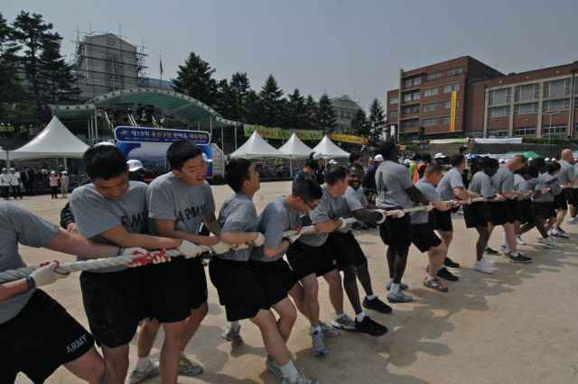 Soldiers play tug of war against members of Yongsan city council at Yongsan citizen field day, April 28. The special day had its purpose to bring citizens' unity and Soldiers from U.S. Army Garrison Yongsan were invited to the event.