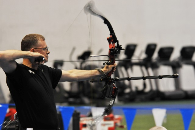 Army Archer Sgt. Fred Prince fires during during the qualification rounds during the archery competition during the 2012 Warrior Gamesat the Air Force Academy in Colorado Springs, Colo. Prince took the silver medal for the compound open category.