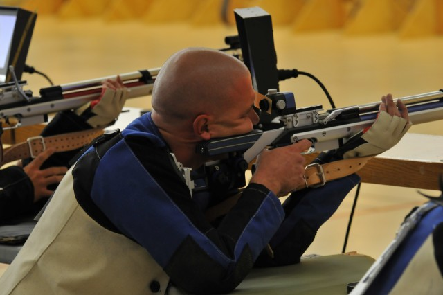 Justin Steele takes aim at the 2012 Warrior Games during the Air Rifle Prone - Open Competition at the Olympic Training Center, Colorado Springs, Colo., May 3, 2012.