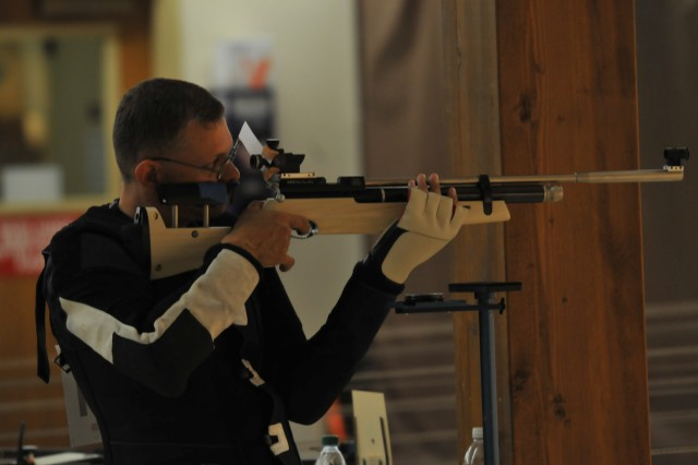 Sgt. Fred Prince takes aim during the qualification round for the Air Rifle Standing - Open Category at the 2012 Warrior Games at the Olympic Training Center, Colorado Springs, Colo., May 3, 2012.