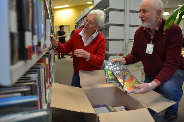Ulrike and Lutz Bergmann, of Lampertheim, Germany, pack books at Miesau Army Depot for Rwanda.