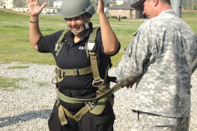 Tacoma Anderson gets properly prepared for an airborne training tower jump at Fort Benning, Ga., during one of the DOD Executive Leader Development Program experiential training opportunities.