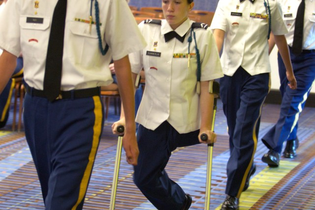 Ariel Summerlin, who was born without a left leg, marches into the inspection room with her fellow Cadets from Airport (S.C.) High School during the National High School Drill Team Championships in Daytona Beach, Fla., May 5, 2012.