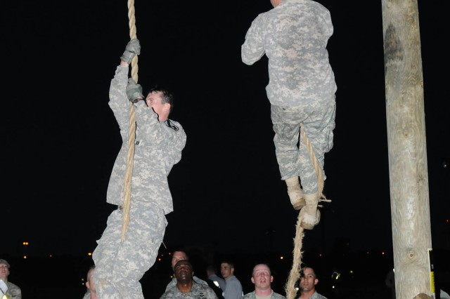 "FORT HOOD, Texas-- Officers assigned to the 4th Brigade Combat Team, 1st Cavalry Division, compete to successfully climb a rope during a competition among each other, March 23, 2012. ""This was a good team-building event,"" said Capt. Robert Cowart, commander for Company C, 2nd Battalion, 12th Cavalry Regiment. ""It gave us a chance to see how everyone reacts in different situations and brought us closer, because we endured the challenge together. It builds camaraderie."""