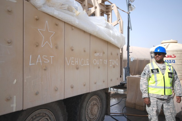 Capt. Kenneth Washington II, transportation officer with Army Field Support Battalion-Kuwait, 402nd Army Field Support Brigade, oversees agricultural customs washing of the last U.S. Army vehicle to leave Iraq at Camp Arifjan, Kuwait, March 3, 2012.