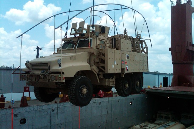 The last mine-resistant, ambush-protected vehicle to depart from Iraq into Kuwait was unloaded at the Port of Beaumont, Texas, at formal ceremony, May 7, 2012.