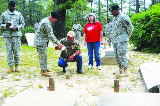 Members of the Fort Polk Heritage Project, with the help of Soldiers from Warrior Transition Unit, honored the recently identified graves of 32 previously unknown local family members buried at Holly Springs Cemetery, April 28, 2012.