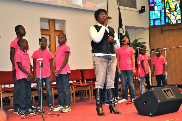 "A Haitian choir team, The ""Miracle"", shows their talent at USAG Yongsan South Post Chapel, May 6. They were all orphans before Reverend Paik Sam-Sook started her missionary work at Haiti since 2002. She has been raising them ever since. (U.S. Army Photo by Pfc. Lee Hyokang)"