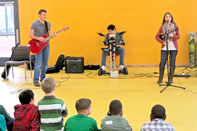 The members of Volition -- Daniel Aslakson (from left), Shin Cousens and Natalia Lynch perform for youths while in San Diego.