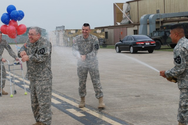 Lt. Col. George G. Ferido (right), deputy brigade commander, 2nd Combat Aviation Brigade, and Lt. Col. David C. Snow (center), commander, 3rd General Support Aviation Battalion, 2nd Aviation Regiment, 2nd Combat Aviation Brigade, congratulate Chief Warrant Officer 4 David R. Lilly for his accomplishment after he completes a record flight May 1, 2012, at Camp Humphreys, South Korea. Lilly exceeded 10,000 flight hours as a rotary-wing pilot in the Army.