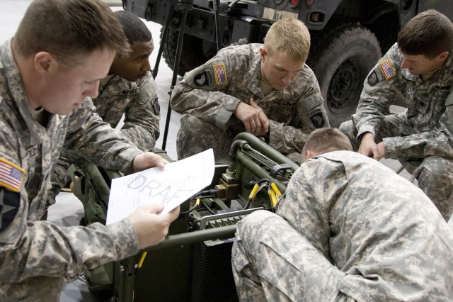 Soldiers from the 101st Airborne division (Air Assault), Fort Campbell, Ky., assist the M119A2 Howitzer logistics Team complete the last phase of logistics training. The M119A2 is scheduled to be fielded in 2013.