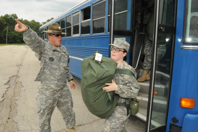 Staff Sgt. Robert Pelkey, Company E, 2nd Battalion, 10th Infantry Regiment drill sergeant, directs Soldiers off the bus to the unit training area on Day Zero of Basic Combat Training in Fort Leonard Wood.