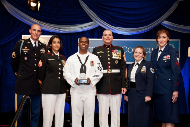 (From left to right) Army Staff Sgt. Tanner Welch, 3rd U.S. Infantry Regiment, The Old Guard, Marine Staff Sgt. Serena Anderson, Office of the Chairman of the Joint Chiefs of Staff, Navy Petty Officer 1st Class Curtis Robinson, Office of the Master Chief Petty Officer of the Navy, Marine Sgt. Maj. Bryan Battaglia, senior enlisted advisor to the Chairman, Air Force Tech Sgt. Lisa Tomlinson, Joint Base Andrews Chapel, and Coast Guardsman Petty Officer 2nd Class Lisa Pique, Surface Force Logistic Center, Baltimore, M.D., attended the annual 2012 Atlantic Council Awards Dinner May 7, 2012, at the Ritz Carlton in Washington, D.C., where they accepted the 2012 Military Leadership Award on behalf of the entire active, guard and reserve enlisted force. Other awardees at the dinner consisted of philanthropist Prince Harry of Wales, violinist Anne-Sophie Mutter, and United Nations Secretary General Ban Ki-Moon.