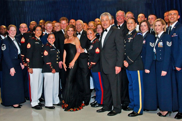 Members of the U.S. Armed Forces take a photo with Prince Harry of Wales, General (retired) Colin Powell, Senator Chuck Hagel, Senior Enlisted Advisor to the Chairman Marine Sgt. Maj. Bryan Battaglia, and violinist Anne-Sophie Mutter backstage during the 2012 Atlantic Council Awards Dinner May 7, 2012, at the Ritz Carlton in Washington, D.C