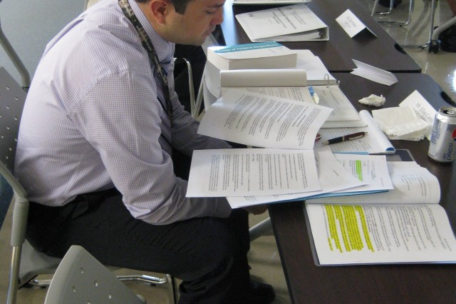 Elias Cantu, safety officer for SDDC, sifts through the exercise book during DTTS 2nd ROC drill May 2.