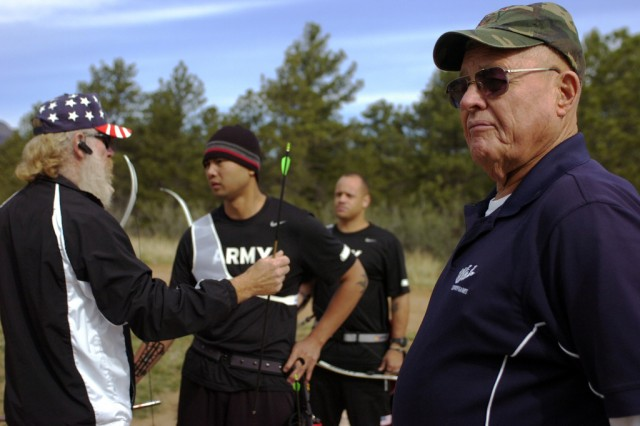 Staff Sgt. Ammala (Al) Louangketh, a native of Boise, Id., and Staff Sgt. Curtis Winston, a native of Zion, Il., receive instruction from retired Sgt. 1st Class Steven Coleman, U.S. Army Archery coach. Ed Eliason, a member of the 1972 U.S. Olympic archery team who competed in the Munich Olympic Games and coach of Coleman for more than three years observes athletes during the final day of training before the start of Warrior Games 2012 competition.