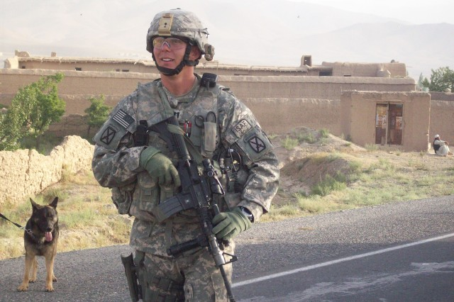 Tyler Kurth conducts a foot patrol during his deployment to Afghanistan.