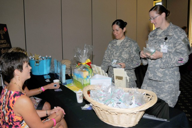 Sgt. Regina William, Lyster Army Health Clinic preventive medicine NCO, and Staff Sgt. Yuniva Gutierrez, Lyster Army Health Clinic preventive medicine NCO, talk with Yvette Smith, a representative from Feagin and Own cosmetic and plastic surgery center, at last year's Women's Health Fair. This year's free Women's Health Fair and Baby Shower takes place May 15 from 10 a.m. to 2 p.m. at The Landing.