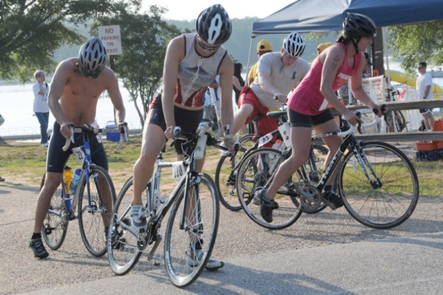 Participants get ready for the biking portion of last year's Audie Murphy Triathlon at Lake Tholocco. As the weather continues to heat up, those working out or participating in outdoor activities need to be mindful of hot weather safety.