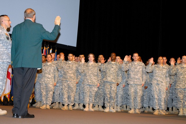 Retired Col. Roger Donlon, Medal of Honor recipient, administers the oath of enlistment to about 60 Soldiers in the 40th Military Police Internment and Resettlement Battalion May 3 in the Lewis and Clark Center's Eisenhower Auditorium at Fort Leavenworth, Kan.