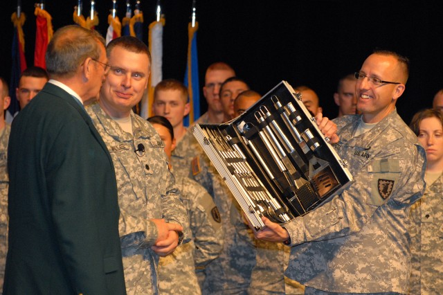 Retired Col. Roger Donlon, Medal of Honor recipient, is presented a barbecue set by 40th Military Police Internment and Resettlement Battalion Commander Lt. Col. Bob Willis Jr. and Sgt. Maj. James Breckinridge in appreciation for administering the oath of enlistment to about 60 Soldiers in the battalion May 3 in the Lewis and Clark Center's Eisenhower Auditorium, Fort Leavenworth, Kan.