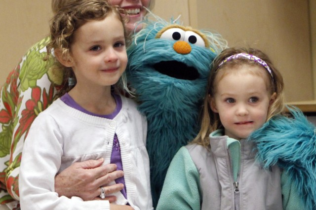 Deanie Dempsey, wife of Chairman of the Joint Chiefs of Staff Gen. Martin E. Dempsey, joined Sesame Street's Rosita at the Lee Child Development Center at West Point May 3 to entertain children with a pizza lunch and songs and a lot of laughs.