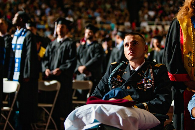 Second Lt. Josh Pitcher attends Saturday's commencement ceremony at Eastern Kentucky University in Richmond, Ky., just three weeks after losing his left foot in an improvised explosive device explosion in Afghanistan. The former EKU Cadet was at the event to see his fiancee, Michelle Smith, receive a degree in social work.