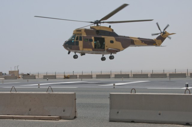 A Kuwaiti military helicopter prepares to land at the troop medical clinic at Camp Arifjan, Kuwait, as part of a medical evacuation exercise, April 26, 2012. Aboard the aircraft, U.S. and Kuwaiti service members care for a simulated casualty injured by a simulated active shooter. Third Army is dedicated to shaping the future by holding joint exercises with partner nations.