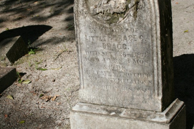 "A grave marker at Gill Cemetery on Fort Stewart for ""Little Horace C. Bragg"" who died when he was 4-years old in September 1873, bears testament to the harsh life of early residents."