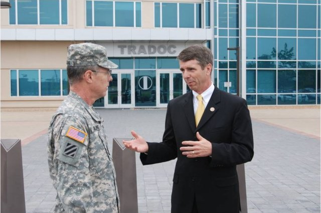 Lt. Gen. John Sterling, Deputy Chief of Staff, U.S. Army Training and Doctrine Command, welcomes Congressman Rob Wittman of Virginia's 1st District to Fort Eustis in front of the TRADOC Headquarters. Wittman was the guest speaker during the post's Annual Public Service Recognition Ceremony.
